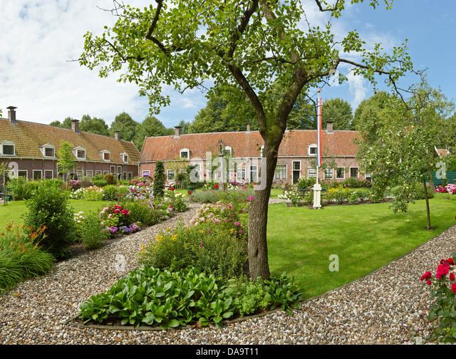 Netherlands, Holland, Europe, Edam, court yard, city, village, flowers, summer, garden, - Stock Image