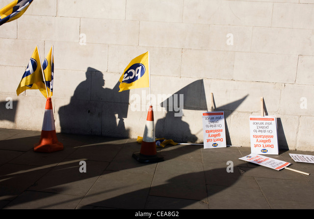 Anonymous staff silhouetted from the Public and Commercial Services Union PCS union outside National Gallery, London - Stock Image