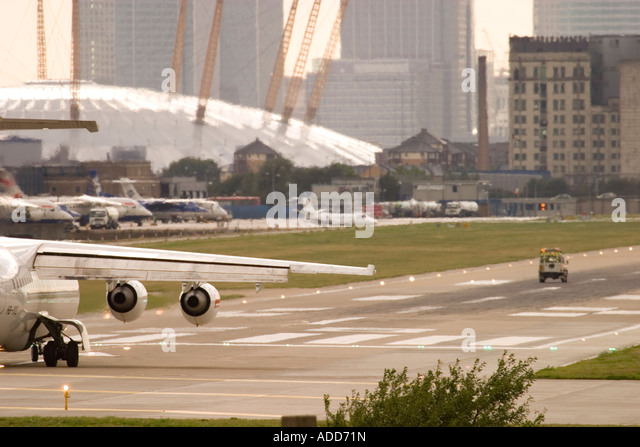 Regional airliner waiting for take off clarence and ground crew checking the runway before departure London City - Stock Image