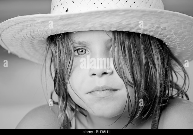 Black and White Shot of a Pretty Child in Summer Hat - Stock Image