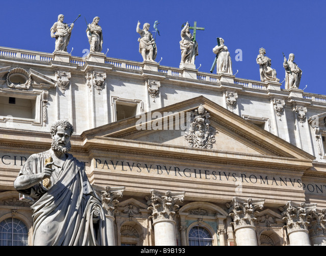 Statue of St Peter and front of St Peter's at the Vatican, Rome - Stock Image