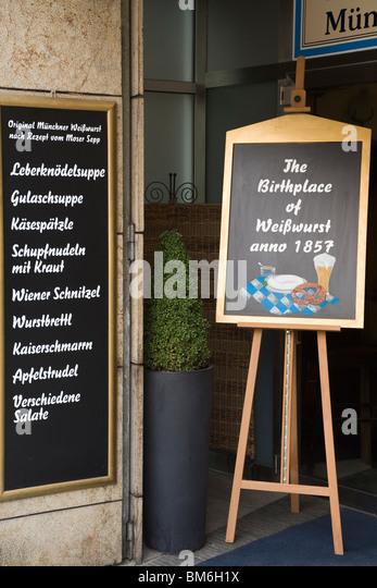 A restaurant on Marienplatz advertises that is the birthplace of the White Sausage (Muencher Weisswurst) in Munich, - Stock-Bilder