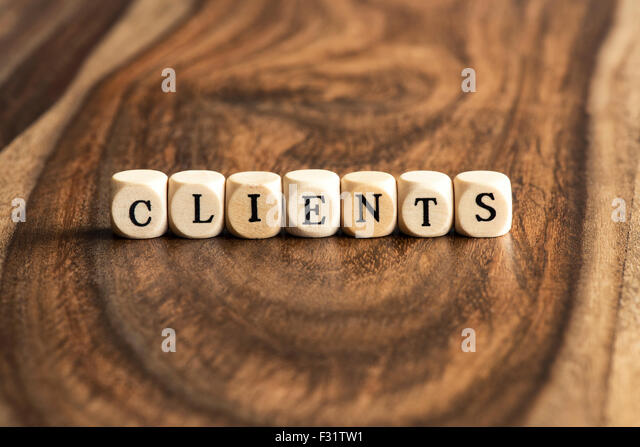 CLIENTS word background on wood blocks - Stock Image