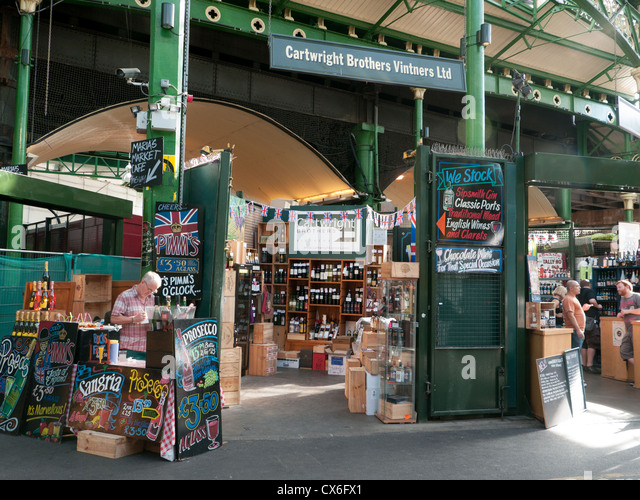 Stall selling all kinds of alcoholic drinks in Borough market, London, UK - Stock Image