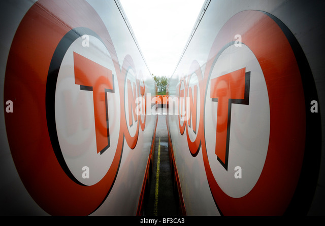 TNT lorries at a depot - Stock Image