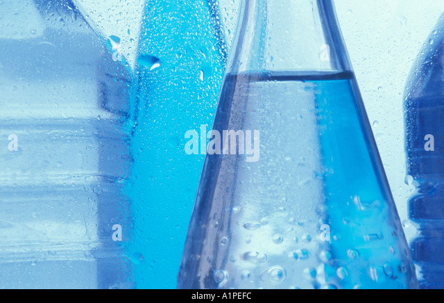 Mid section of cold bottled water - Stock Image