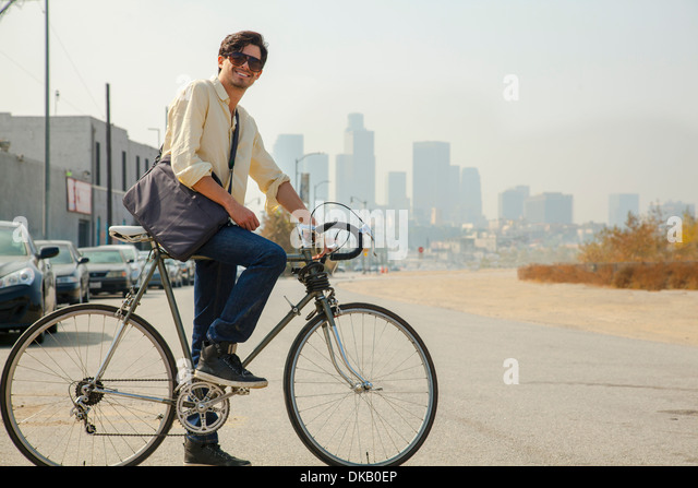 Young man on cycle, Los Angeles, California, USA - Stock Image