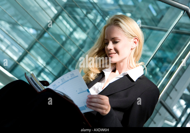 Business woman with diary, portrait - Stock Image