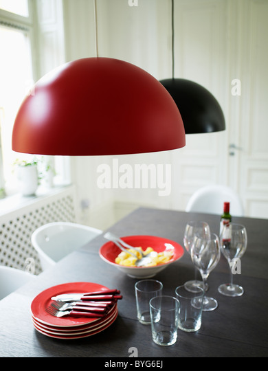 Modern design table with meal for three ready to eat - Stock-Bilder