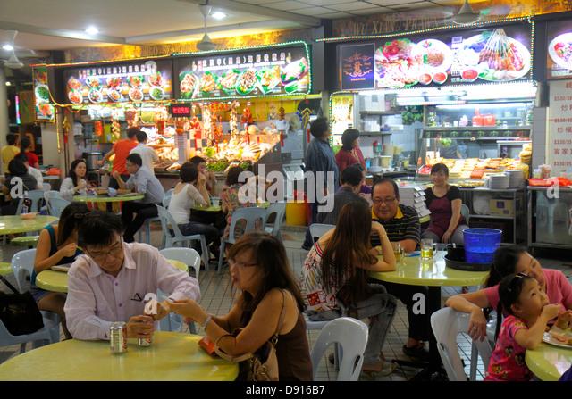 Singapore Jalan Besar Lavender Food Centre center court Asian cuisine food restaurant hanzi characters Chinese man - Stock Image