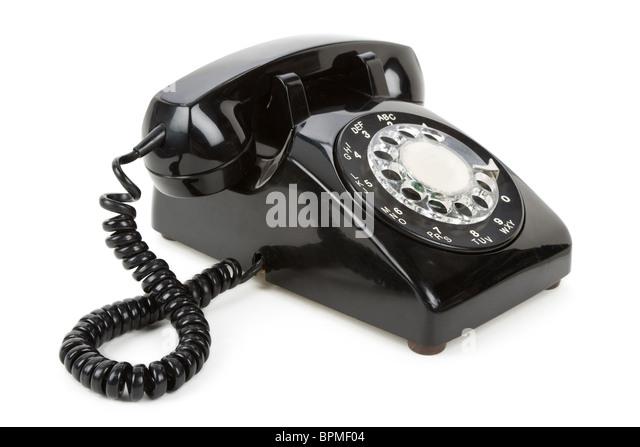 Black telephone with white background - Stock Image