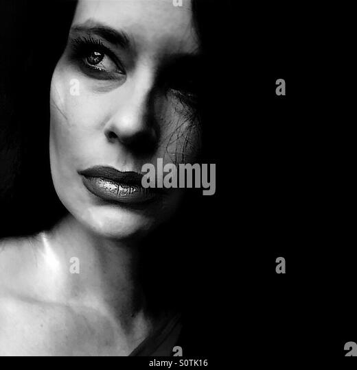Black and white closeup portrait of woman - Stock Image