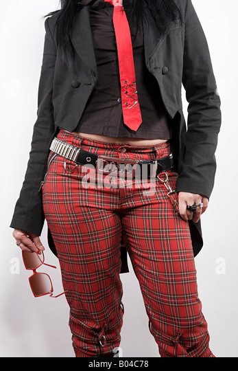 Woman wearing tartan trousers - Stock Image