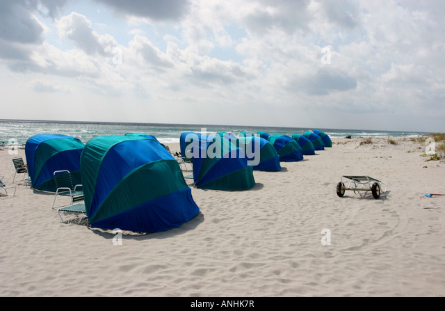 blue green sun shades on beach - Stock Image