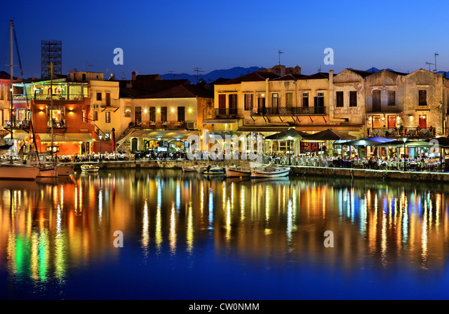 The old Venetian harbor of Rethymno town around the 'blue' hour. Crete island, Greece. - Stock Image