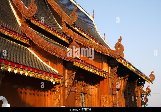 Side view of the magnificent Lanna-style teakwood viharn (sermon hall) at the Buddhist temple complex of Wat Ban - Stock-Bilder