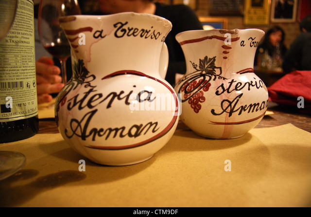Osteria Arman restaurant  Treviso, italy - carafes of wine on the table - Stock Image