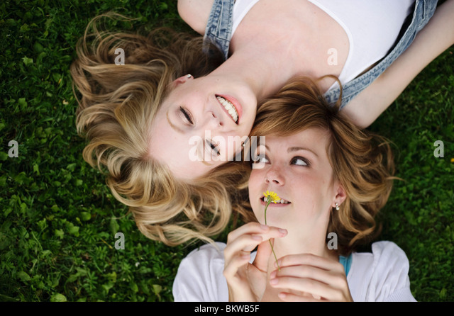 Closeup from above on two girls - Stock Image