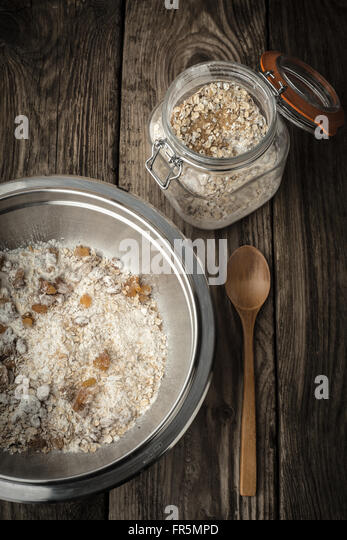 Components and accessories for cookies on gray disks vertical - Stock Image