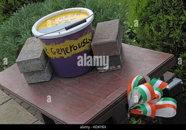 Falls road peace garden memorial collection tin,Falls road,West Belfast,Northern Ireland,UK - Stock Image