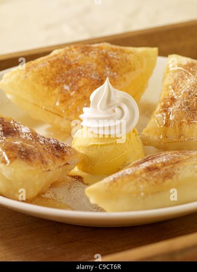 Sopapillas with vanilla ice cream and whip cream - Stock Image