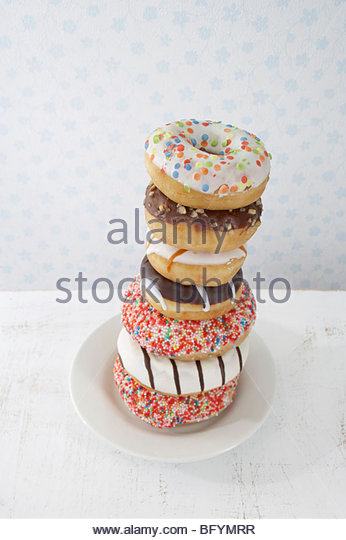 pile of donuts on plate - Stock Image