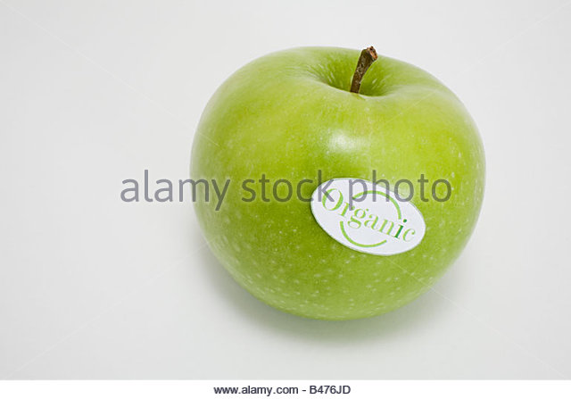 An apple with an organic label on it - Stock Image