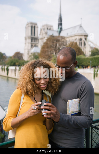 African couple looking at camera - Stock-Bilder