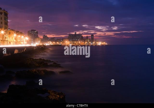 Malecon sea drive at dusk, City of Havana, Havana, Cuba - Stock Image