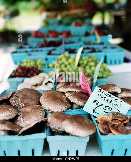Mushrooms on market stall - Stock Image