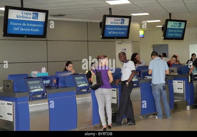 Panama City Panama Aeropuerto Tocumen airport PTY aviation terminal Copa Airlines carrier counter kiosk passenger - Stock Image