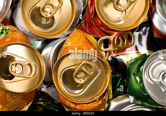 Background of various crashed beer cans. - Stock Image