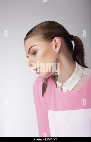 Sentimental Dreamy Woman in Pink Blouse - Stock Image