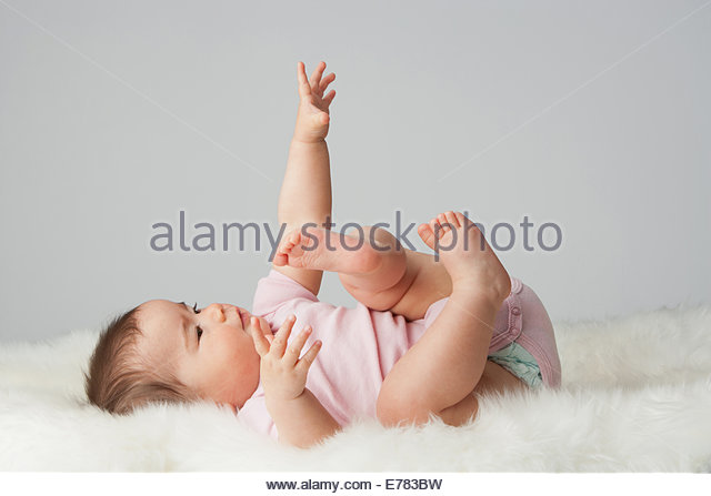 A baby lying down - Stock Image