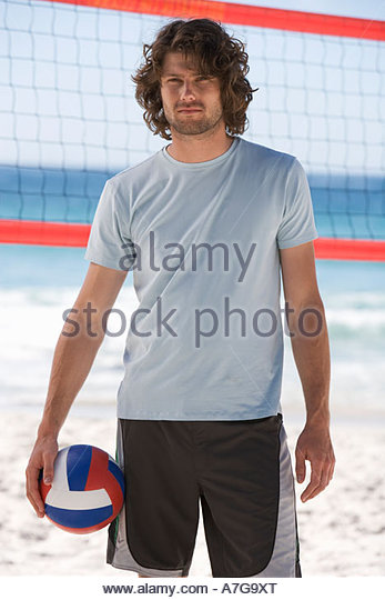 A man playing beach volleyball - Stock Image