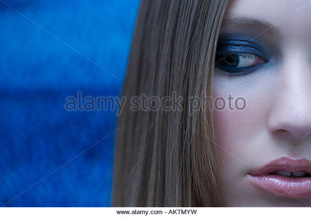 Portrait of a woman and a television screen - Stock Image