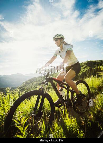Woman during bike trip - Stock Image