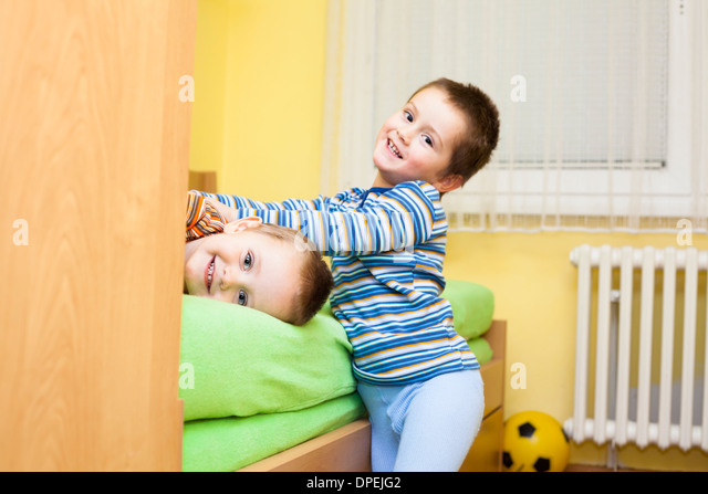 Two happy children playing at home - Stock Image