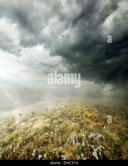 Clouds and rain in the autumn field - Stock Image