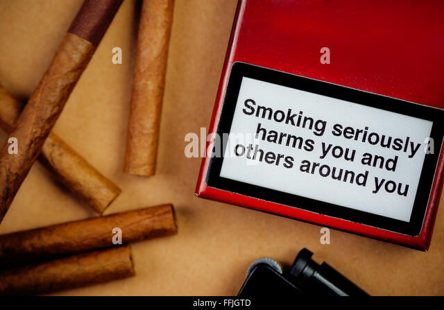 Smoking cigarettes addiction and health issue concept, flat lay arrangement, smoking seriously harms you and others - Stock Image