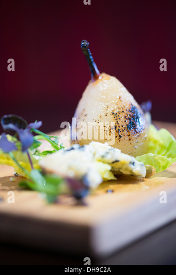 Pear and blue cheese afters from a fine dining restaurant - Stock Image