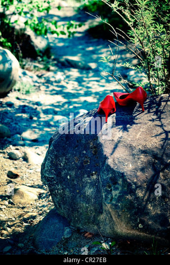 red shoes on rocks - Stock Image