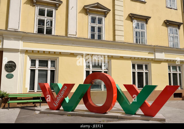 Red and green interactive WOW art installation at the Slovenian Tourist Information Centre of Ljubljana celebrating - Stock Image