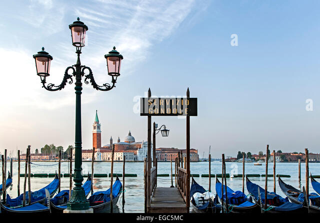 Gondolas dock, lamp post and San Giorgio Maggiore Church, Venice, Italy - Stock Image