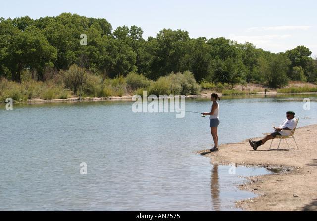 New Mexico Albuquerque Rio Grande Park cottonwood trees fishing T - Stock Image