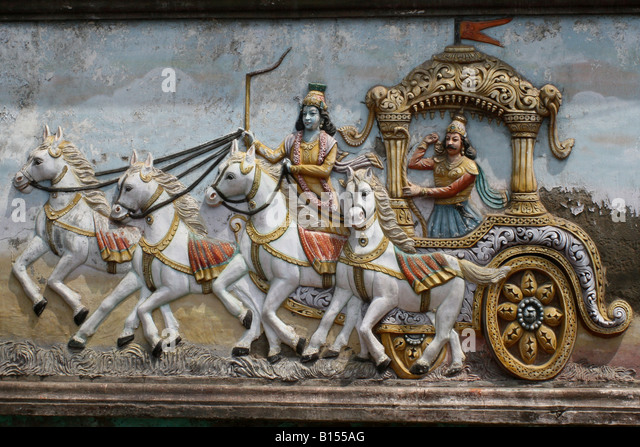 Mural on Hindu temple wall showing Arjuna and Krishna in their chariot , Kurukshetra war , India - Stock Image