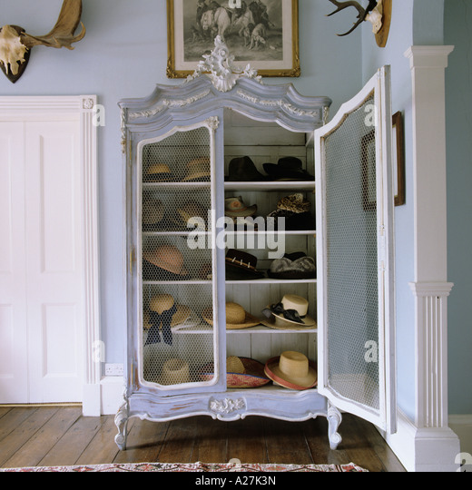 Hat collection in old French wardrobe - Stock-Bilder