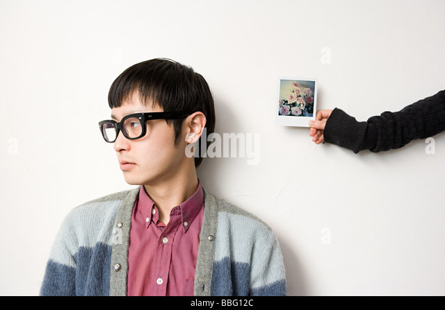 Young man and photograph - Stock Image