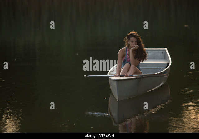 Teenage girl boating in the evening - Stock Image