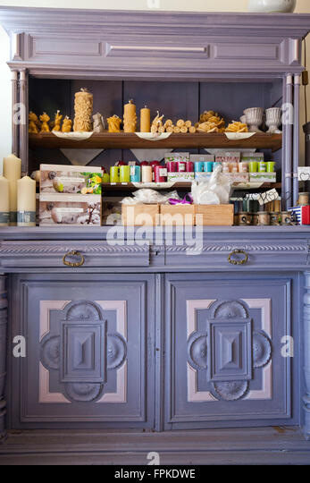 nostalgic cupboard with candles - Stock Image